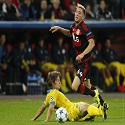 Bayer Leverkusen's Kampl fights for the ball with BATE Borisov's Baga during their Champions League group E soccer match in Leverkusen